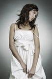 Sad woman in white dress Stock Photos