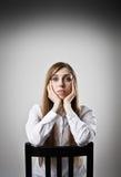 Sad woman in white Royalty Free Stock Image