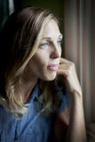 Sad Woman At The Window Royalty Free Stock Images