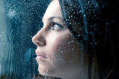 Sad Woman On Window In The Rain Stock Photos