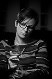 Sad woman with wine glass stock photos