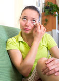 Sad woman wiping tears Stock Image