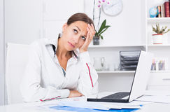 Sad woman working Royalty Free Stock Image