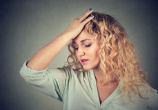 Sad woman with worried stressed face expression looking down stock photos