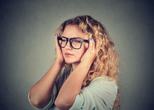 Sad woman with worried stressed face expression looking overwhelmed royalty free stock photos