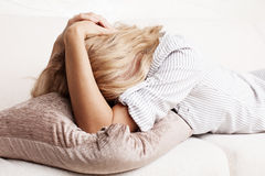 Sad woman. Sad young woman at home. Female grief Stock Photo