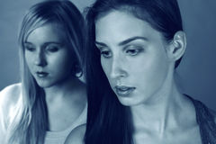 Sad women. Two sad women feeling low and depressed, a closeup of faces royalty free stock photos
