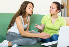Sad women with documents and laptop indoor Stock Image