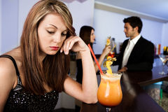 Sad women and happy couple in the background Royalty Free Stock Photography