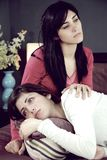 Sad women holding each other feeling depressed Royalty Free Stock Images