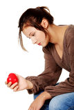 Sad women holding heart in her hand. Royalty Free Stock Photos