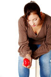 Sad women holding heart in her hand. Royalty Free Stock Photography