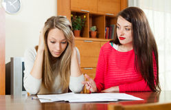 Sad women looking financial documents Royalty Free Stock Photos
