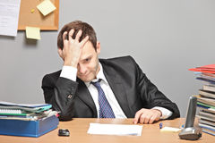 Sad worker. In an office stock image