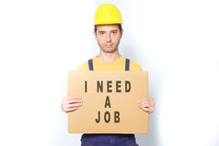 Sad worker holding a cardboard isolated on white Stock Photography
