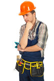 Sad workman looking down. Sad young workman looking down and thinking isolated on white background Royalty Free Stock Photography