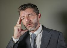Sad and worried businessman in suit and tie and messy look feeling depressed and stressed in overwhelmed face expression suffering stock images