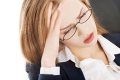 Sad, worried caucasian business woman sitting. Royalty Free Stock Images