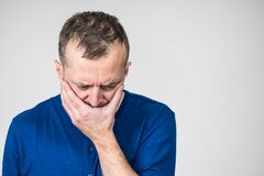 Free Sad Worried Man Covering His Mouth Royalty Free Stock Image - 214896776