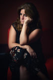 Sad, worried or nostalgic woman sitting lonely royalty free stock images