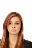 Sad or worried teenage pretty woman Stock Images