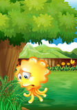 A sad yellow monster under the tree Stock Photo