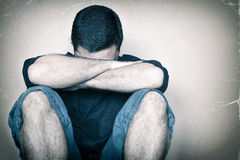 Sad youg man sitting on the floor crying Royalty Free Stock Images