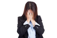 Sad young Asian businesswoman cry with palm to face Royalty Free Stock Image