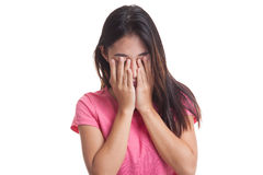 Sad young Asian woman cry with palm to face Royalty Free Stock Photography