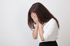 Sad young Asian woman cry with palm to face. Stock Photos
