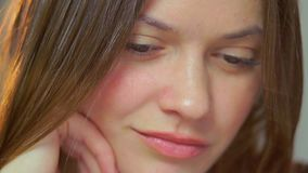 Sad young beautiful woman  make-up contemplating looking down. Stock footage stock video footage
