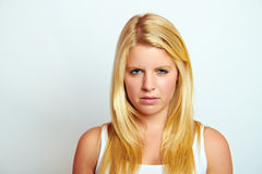 Sad young blond girl Stock Image