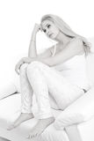 Sad young blonde woman isolated on white Royalty Free Stock Photos