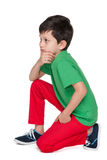 Sad young boy in the green shirt Stock Photo