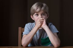 Sad young boy Stock Images
