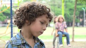 Sad Young Boy at Playground stock footage
