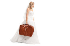 Sad young bride walking with suitcase Royalty Free Stock Images