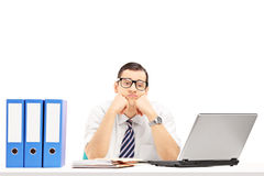 Sad young businessman in his office Royalty Free Stock Photos