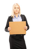Sad young businesswoman holding a piece of cardboard Stock Images