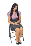 Sad young corporate woman on chair Royalty Free Stock Photo