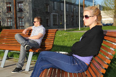 Sad young couple sitting in park Stock Photography