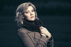 Sad young fashion blond woman walking in night outdoor Stock Photography