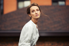 Sad young fashion business woman on city street Royalty Free Stock Images