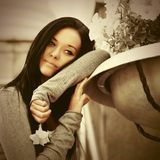Sad young fashion woman in gray pullover day dreaming. Sad young woman day dreaming on city street Fashion model wearing gray pullover royalty free stock images