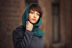 Sad young fashion woman in grey classic coat Royalty Free Stock Photography