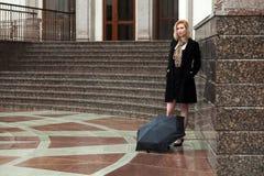 Sad young fashion woman with umbrella Stock Image
