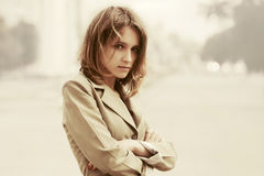 Sad young fashion woman walking in a city street Royalty Free Stock Photography