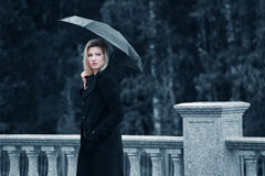 Sad Young Fashion Woman With Umbrella Walking Outdoor Royalty Free Stock Photos