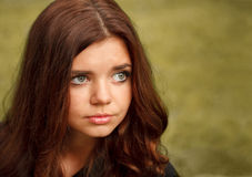 Sad young female. Closeup portrait of sad young female outdoors looking away Stock Image