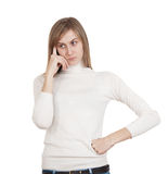 Sad young girl. In white sweater hand to face thought Royalty Free Stock Photo